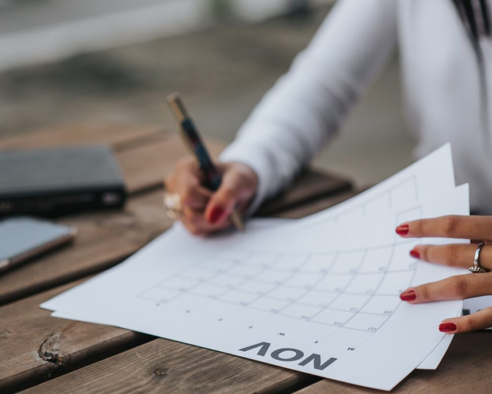 Legal completion date being written on calender